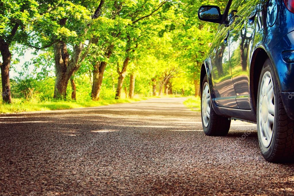 depositphotos 82676224 stock photo car on asphalt road in